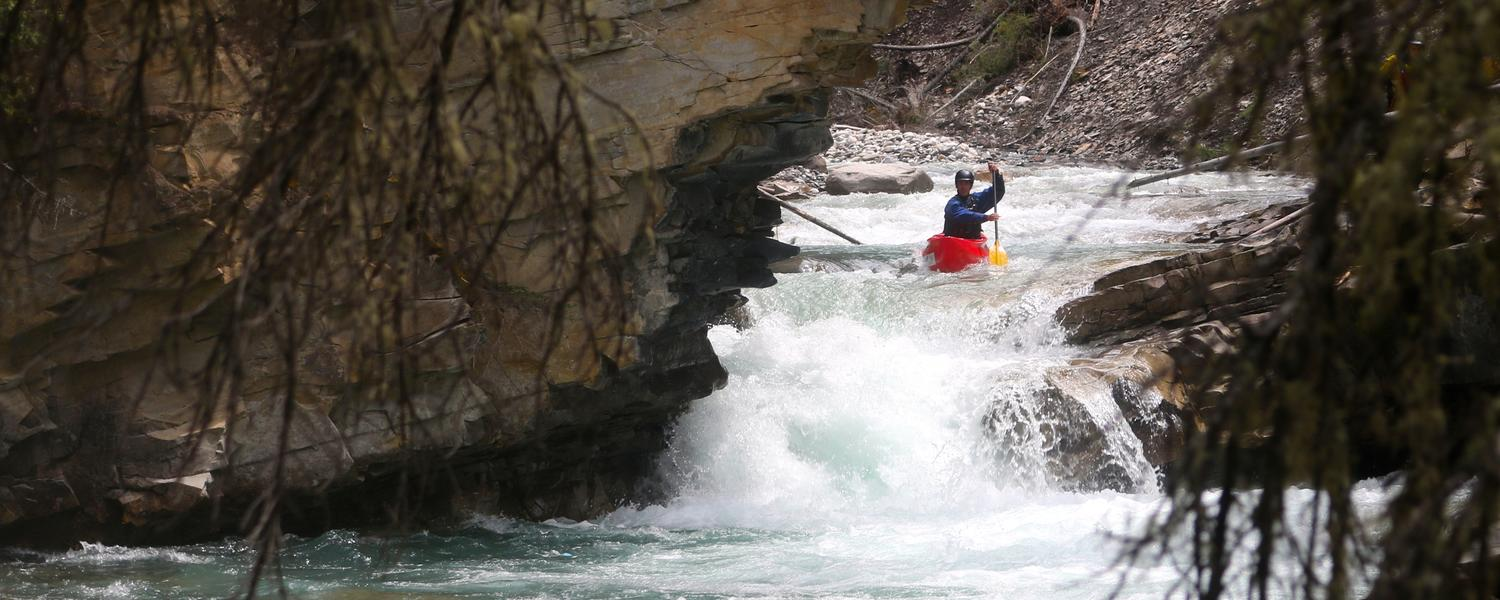 Fin solo canoeing in Johnston Canyon whitewater